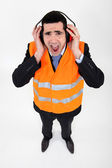 Man covering his ears with earmuffs — Stock Photo