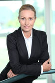 Smiling woman in a suit — Stock Photo