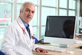 Doctor at his desk — Stock Photo