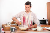 Man stirring mixture in bowl — Stock Photo
