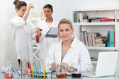A group of scientists carrying out experiments — Stock Photo
