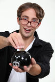 Geeky man saving money — Stock Photo