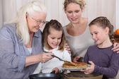 Three generations enjoying crepes — Stock Photo