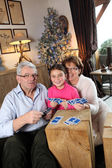 Grandparents playing game with little girl — Stock Photo