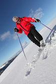 Mature man skiing — Stock Photo