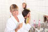 Three housemates in bathroom — Stock Photo