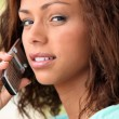 Young woman on a cellphone — Stock Photo #9152715