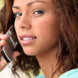 Young woman on a cellphone — Stock Photo