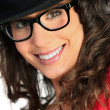 Stock Photo: Womwith hat and glasses