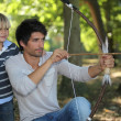 Young man with archer and kid — Stock Photo
