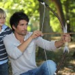 Young man with archer and kid — Stock Photo #9153471