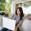 Woman using her laptop outdoors — Stock Photo
