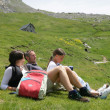 Parents and daughter taking a break from hiking — Stock Photo #9153555