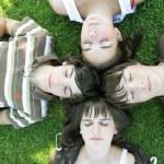 Teen lying on the grass — Stock Photo