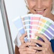Female decorator with selection of color swatches — Stock Photo #9154157