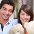 Couple of teenagers with teddy bears — Stock Photo
