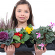 Little girl holding a bunch of flowers. — Stock Photo #9154464