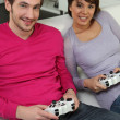 Couple playing video games — Stock Photo #9154522