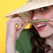 Playful woman holding a green bean above her upper lip — Stock Photo #9154525