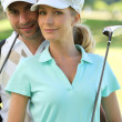 Stock Photo: Couple golfing
