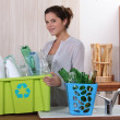 Stock Photo: Brunette recycling empty bottles