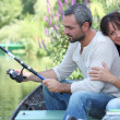Couple fishing on a river — Stock Photo