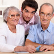 Stock Photo: Grandson posing with his grandparents