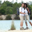 Couple at a lake — Stock Photo