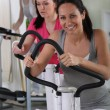 Female using an exercise machine in the gym — Stock Photo