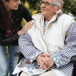Granddaughter with her grandmother in wheelchair — Foto de Stock