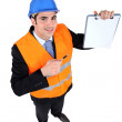 Engineering inspector with a clipboard left blank for your message — Stock Photo #9156095
