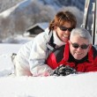 Older couple playing in the snow — Stock Photo #9156135