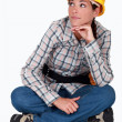 Woman laborer sitting on the ground — Stock Photo #9156387