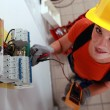 Female electrician checking fuse box — Stock Photo #9156965