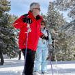 Old couple skiing together — Stock Photo #9156981