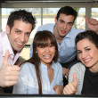Office workers giving a thumbs up — Stock Photo