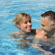 Man and woman in a swimming pool - Stock Photo