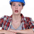 A wide-eyed tradeswoman — Stock Photo