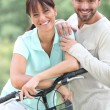 Couple with bike — Stock Photo