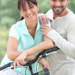 Royalty-Free Stock Photo: Couple with bike
