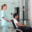 Stock Photo: Nurse helping min wheelchair