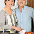 Stock Photo: Portrait of womcooking with her husband