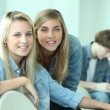 Two blond teenagers smiling at camera — Stock Photo #9159339