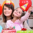 Stock Photo: Little girl at birthday party