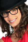 Woman with hat and glasses — Stock Photo