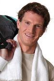 Man with gym bag — Stock Photo
