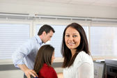 Woman and colleagues in an office — Stock Photo