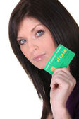 Brunette holding social security card — Stock Photo