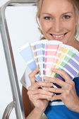Female decorator with a selection of color swatches — Stock Photo