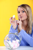 Woman eating marshmallow — Stock Photo